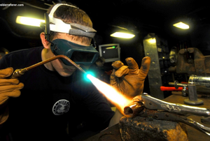 a man welding a metal part