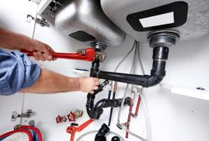 plumbing beneath a sink