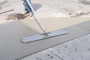 repairing concrete sidewalk