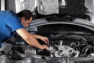 a person working on a car