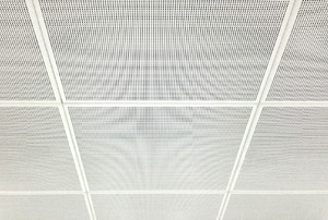 Perforated, white ceiling tiles.