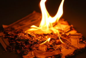 A pile of burning money.