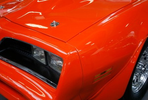 An orange car with a shiny finish.