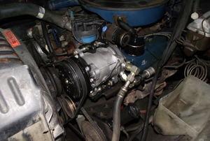 AC compressor alongside other engine parts