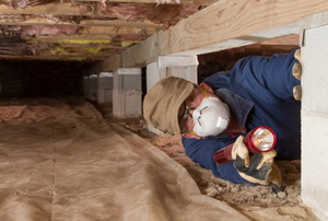 person wearing a mask in a crawlspace