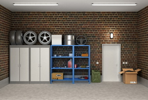 Organized garage with shelving and cabinets