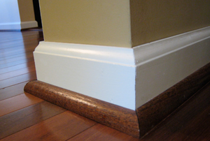 wall with white baseboard molding