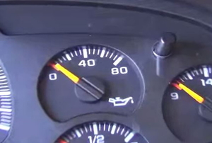 An oil pressure gauge in a car's instrument panel.