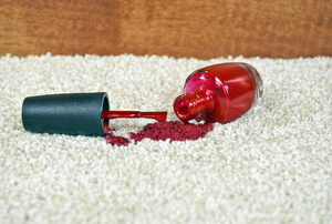 A nail polish stain on carpet.