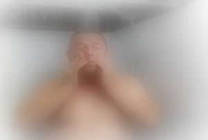 A big man in a steamed up shower.