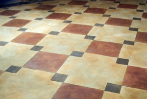 painted faux tiling on concrete floor