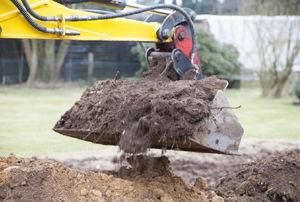 A tractor shoveling dirt.