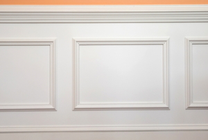wainscotting panels on a peach colored wall