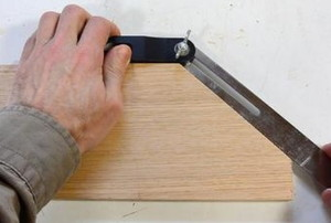 hands using a bevel on wood