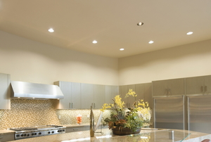 A kitchen with recessed lighting.