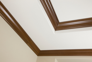 The corner of a ceiling with double crown molding.