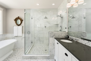 A modern bathroom with a frameless shower door.