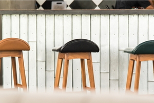 Row of bar stools at a kitchen island