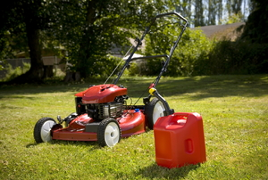lawn mower and gas can on the grass