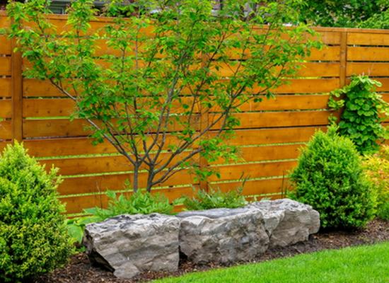 elegant garden fence with horizontal slats