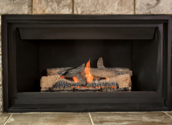 gas fireplace with natural stone surround