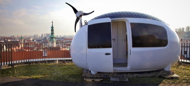 futuristic egg-shaped habitation pod on a grassy space in a city