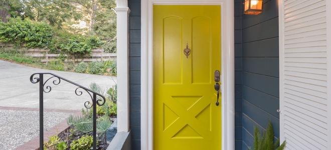 A home's yellow front door.