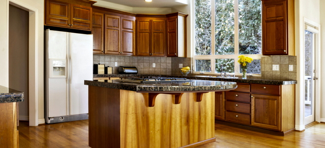 Refinishing Wood Cabinets in Your Kitchen | DoItYourself.com
