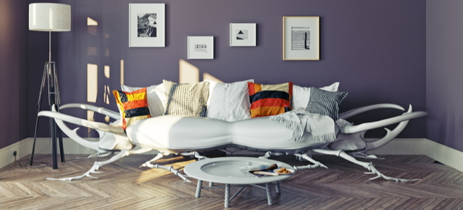 A couch shaped like a beetle with thick cushions and pillows on a frame of spiky sticks or antlers