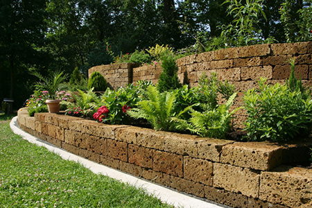 Build a retaining wall in your yard for How to build a stone house yourself