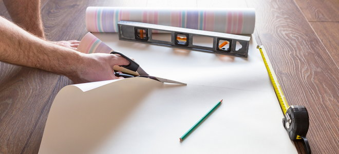 A level being used to cut wrapping paper.