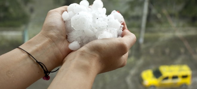 A person holding hail
