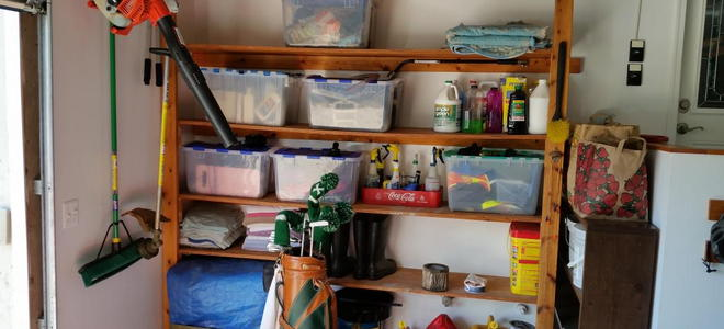A garage with items organized by group on shelves.