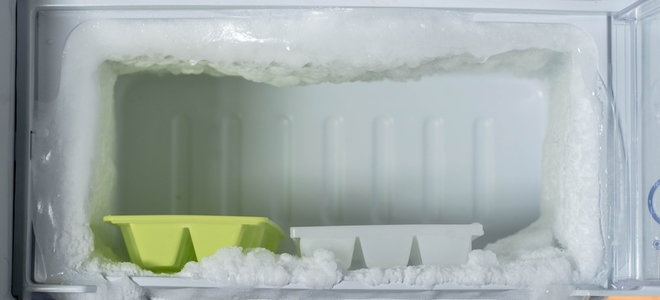 freezer with ice trays and frost build-up