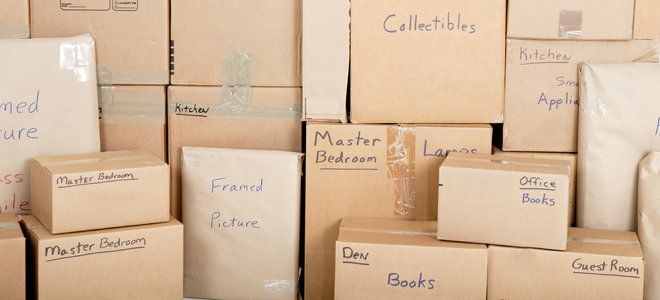 marked moving or storage boxes with objects from different rooms