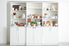 white shelving unit filled with kitchen essentials