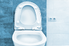 A porcelain toilet without a water tank