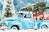 Vintage toy truck with a tiny Christmas tree and gifts