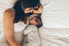 woman and baby laying in bed