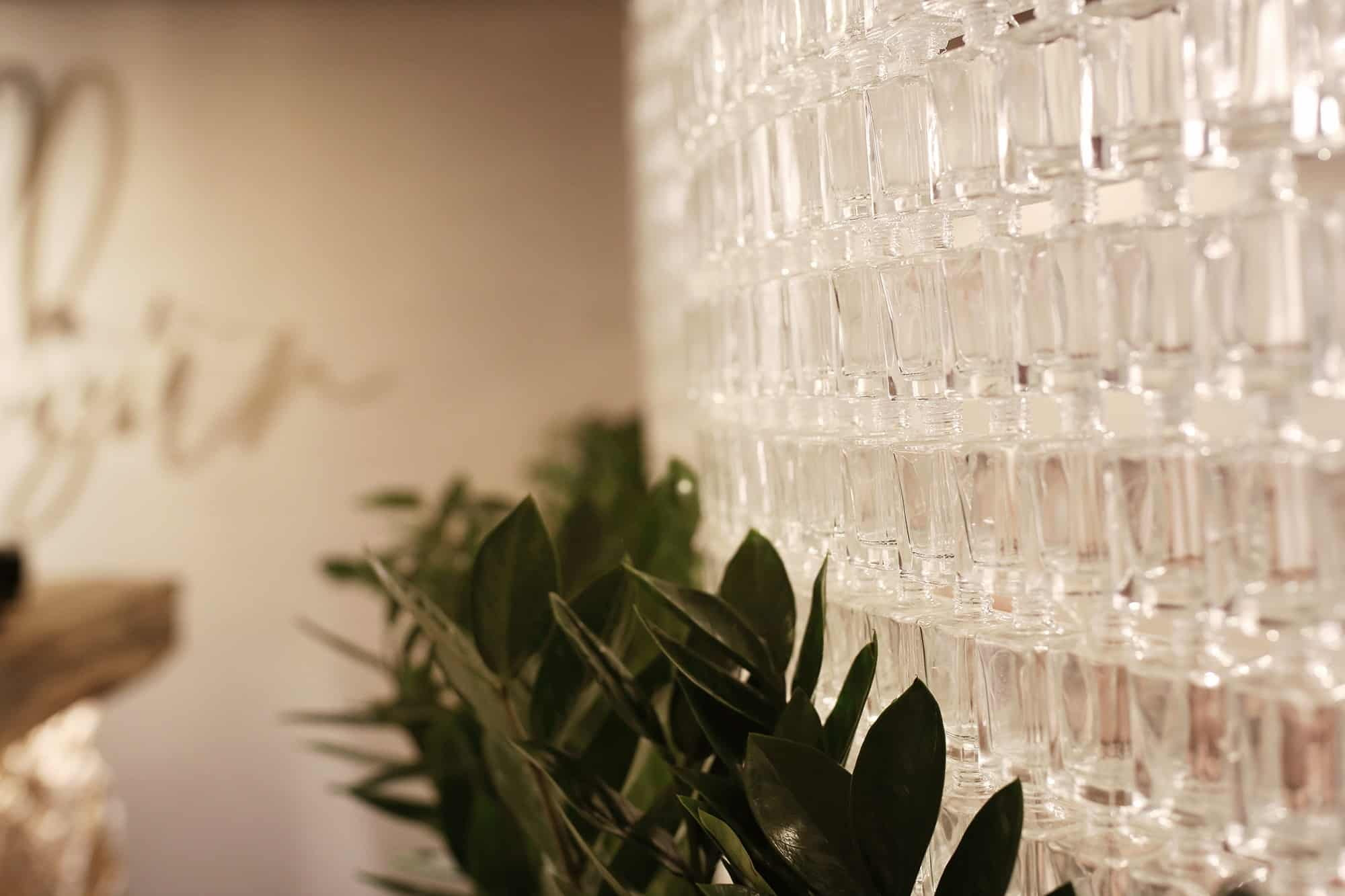 Nail polish bottles have been cut to form a dazzling glass wall inside the Angel Salon.