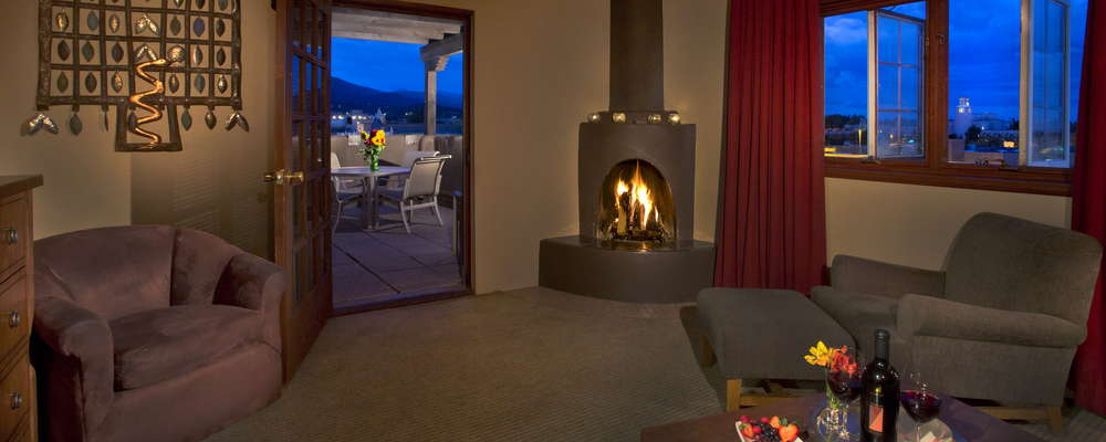 Many suites provide the warm ambiance of a wood burning kiva fireplace.