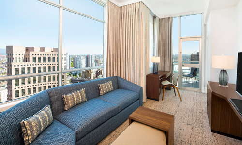 Some suites feature a step out balcony to enjoy the city and mountain views.