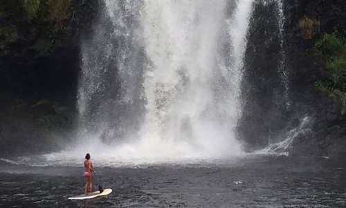 Stand up paddle board (SUP) under Kulaniapia Falls
