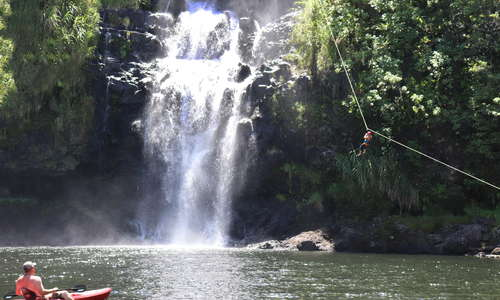 Zip Rappelling into our natural pool under Kulaniapia Falls