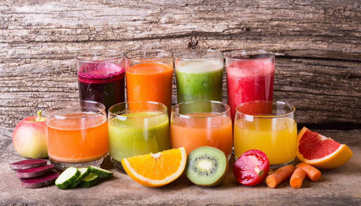 Various different juices with fruit