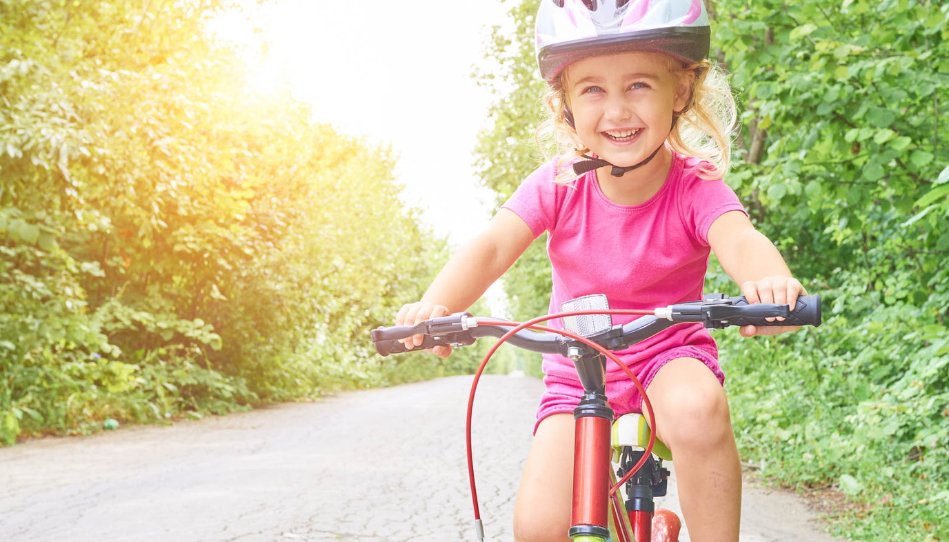 Happy child riding bike