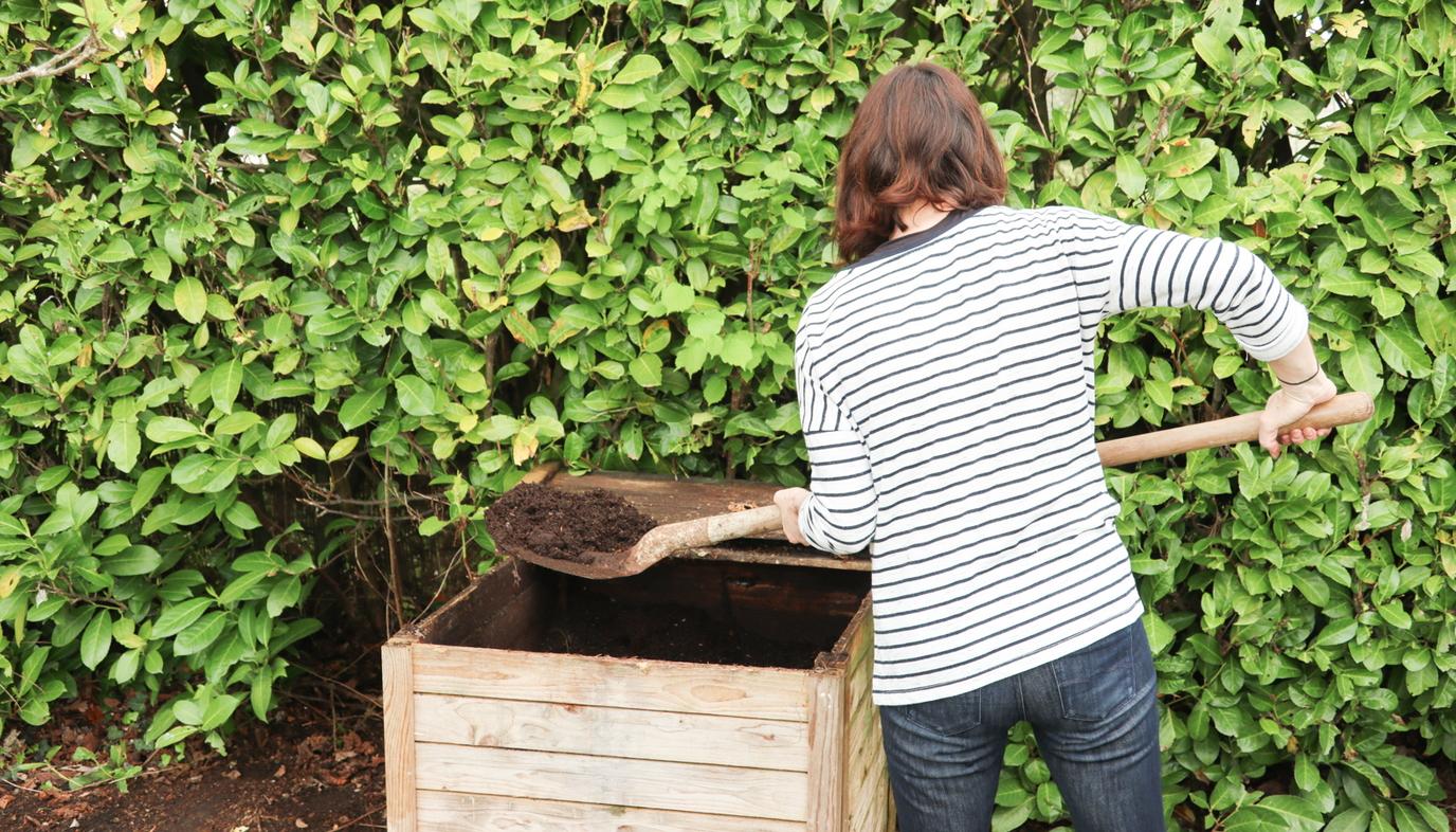 boy shoveling compost