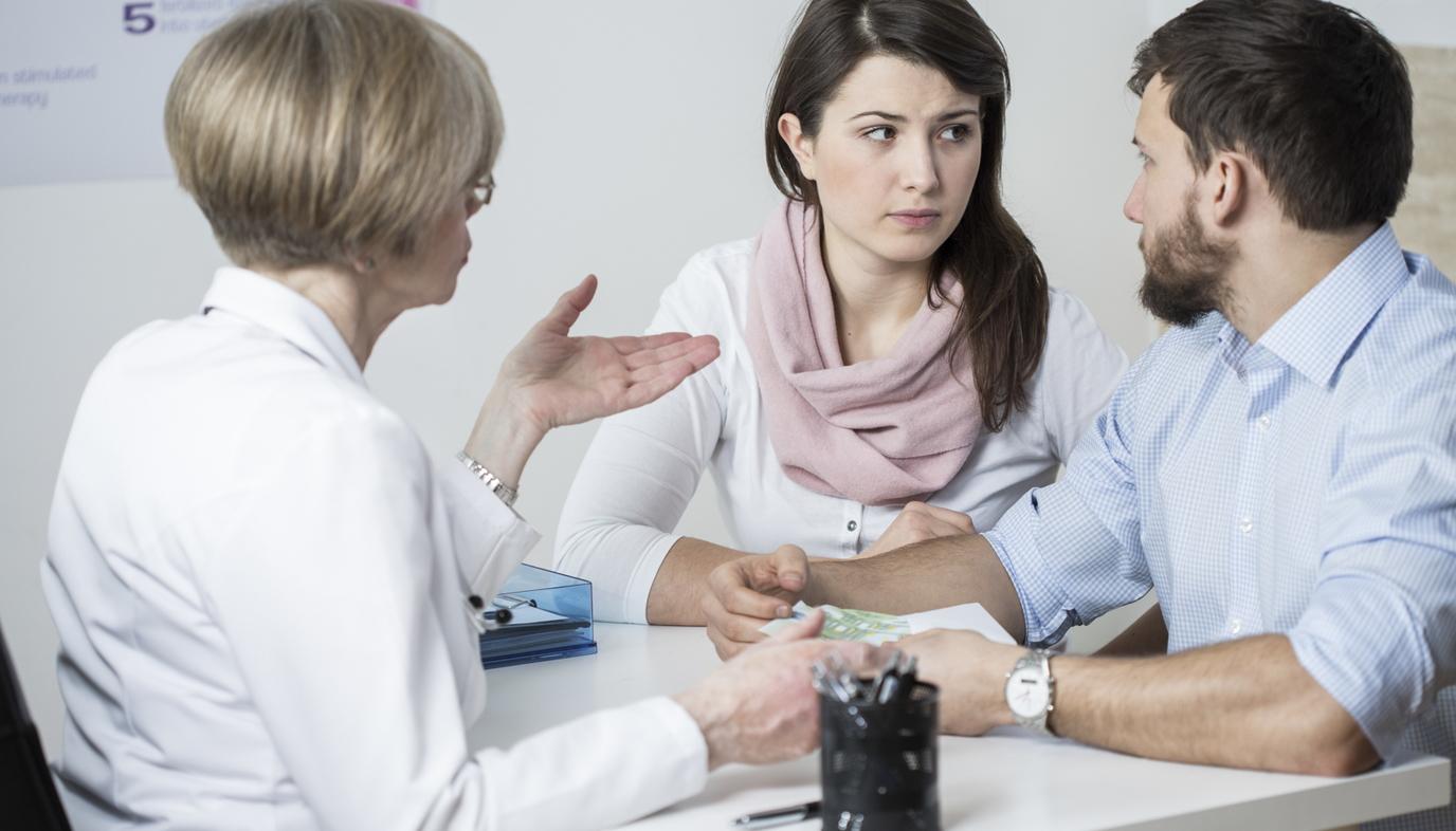 couple talking to fertility doctor