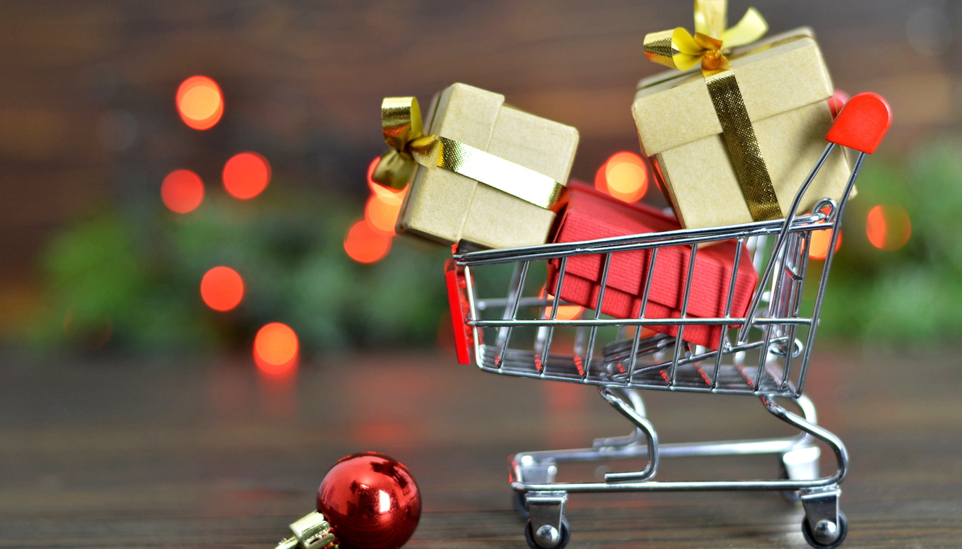 minature shopping cart with Christmas presents in it