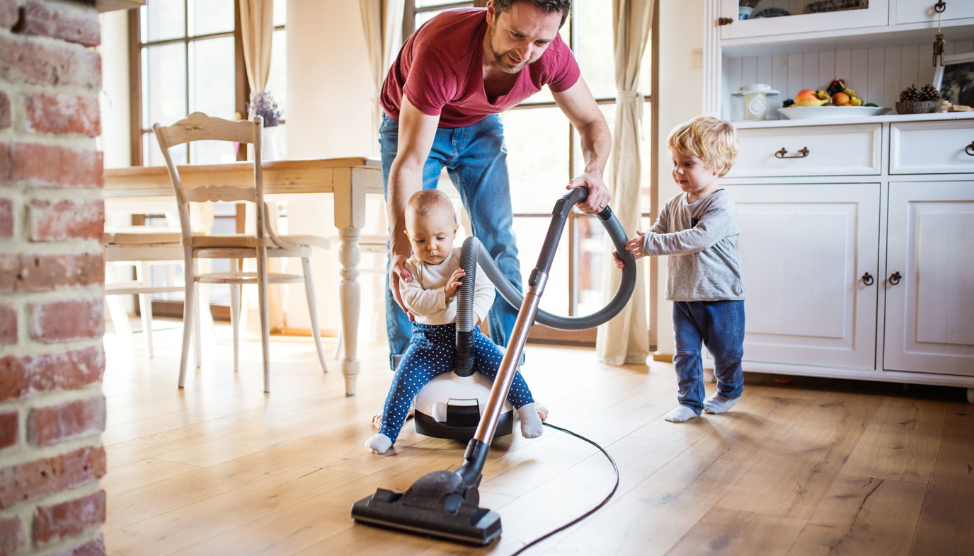 dad vacuuming with kids